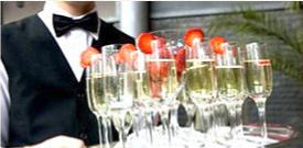 Server delivering champagne flute glasses
