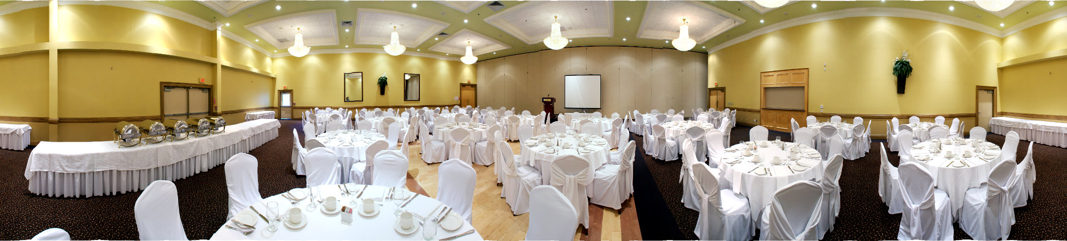 all white corporate setup with buffet and podium