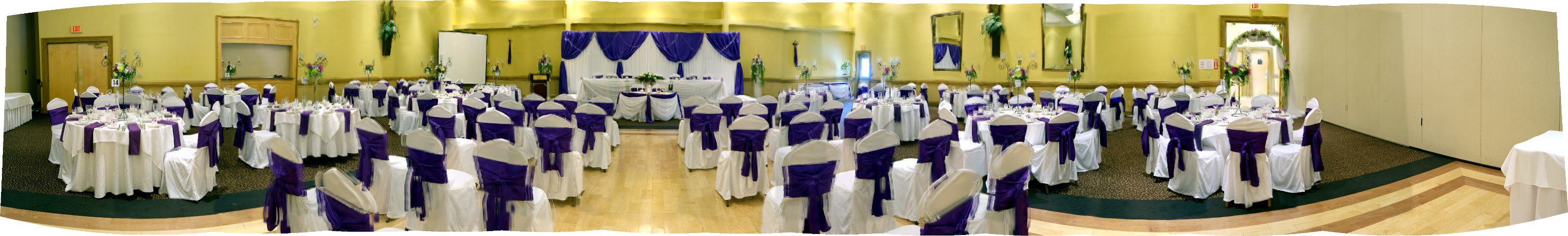 wedding ceremony in hall c with navy blue chair covers