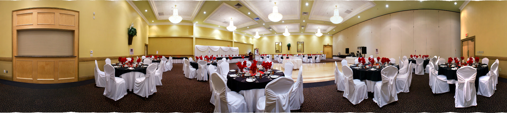 wedding reception dinner in hall c with red table cloths