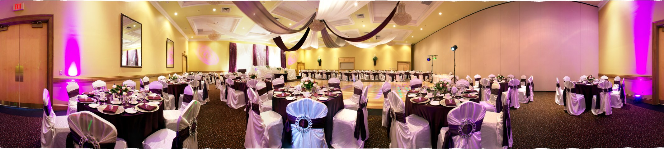 purple wedding decorations in hall