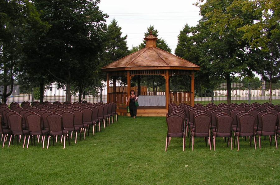 Chairs at gazebo in preparation for outdoor wedding