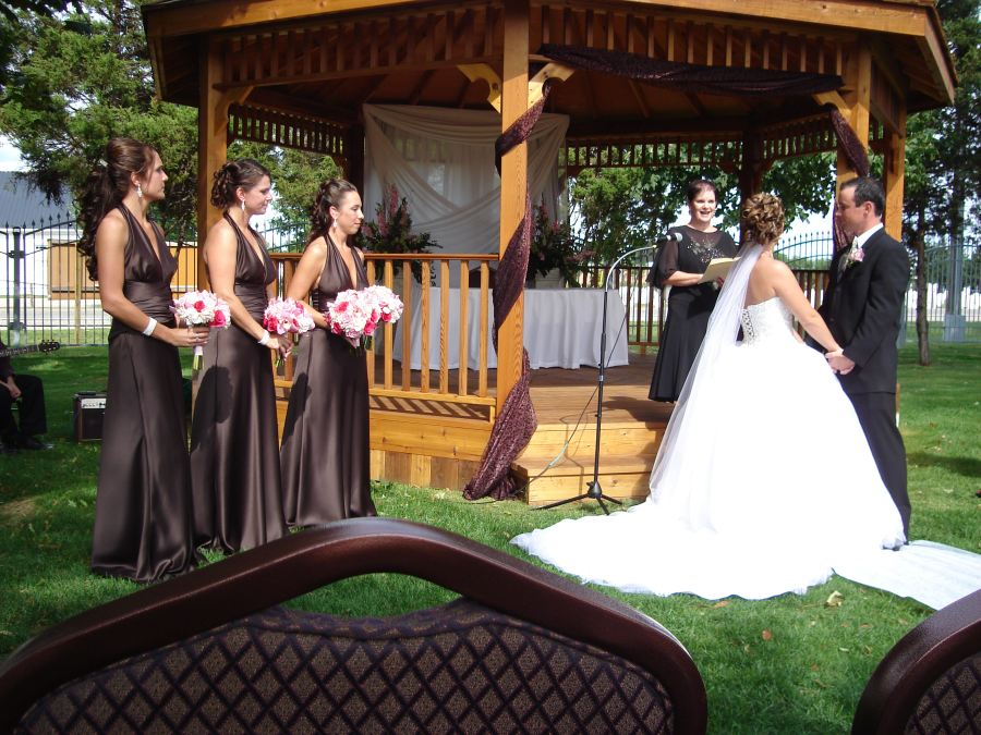 Bridesmaids and outdoor wedding in front of gazebo