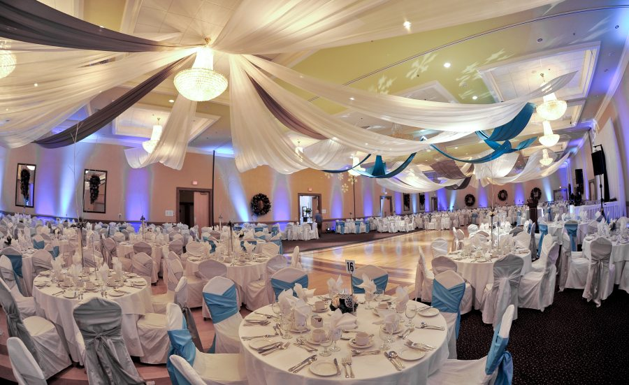 Grand hall decorated in white and blue for wedding