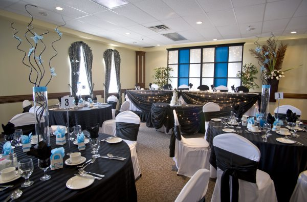Restaurant decorated for wedding in black and teal, blue